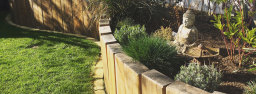 A curved raised flower bed made from white oak.