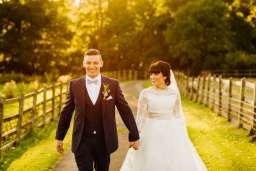 bride and groom walking together timemmerton.co.uk