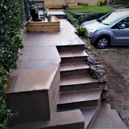 New stone steps and a path/patio area was created
