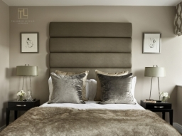 A calm and sophisticated bedroom by Tailored Living Interiors