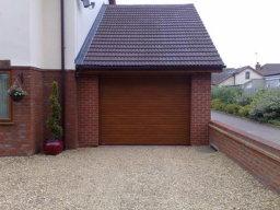 Gliderol Insulated electric Roller Door golden oak