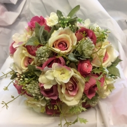 Brides Bouquet of silk flowers and foliage in shades of cream and pink