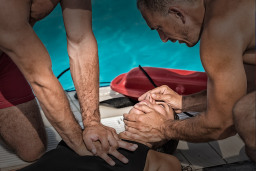 example of people performing cpr and first aid