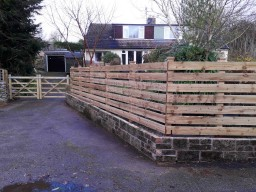 The wall was rebuilt and a bespoke fence built