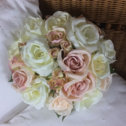 a brides bouquet of dusky pink and ivory silk roses