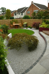 curving walls, round lawn and trellised boundary