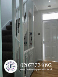 Cleanly Painted in White Door Stairs & Bannisters