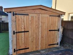 Solid larch garage doors
