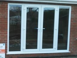 French door with fully glazed side panels