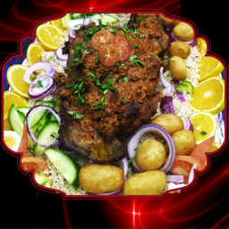 leg of lamb on bed of rice with roast potatoes