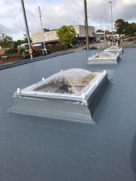 Flat roof with windows installed.