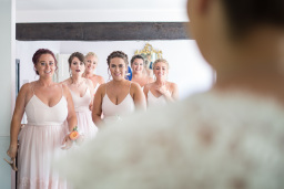 Bridemaids looking in in awe at the bride.