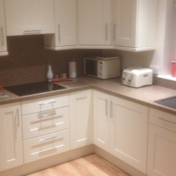 After.  New doors, drawers, handles and work tops have given this kitchen a lift at a fraction of the price of installing a complete new kitchen