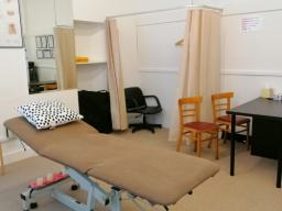 Wrexham Osteopath Clinic interior. Couch and Desk.