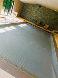 Indoor pool automatic safety cover