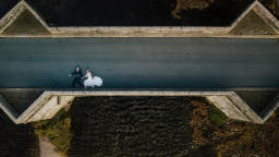 A bride and groom on a bridge in Yorkshire