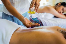 therapist at beauty by laser applying massage oil