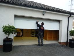 Sectional garage doors by TiltAdor