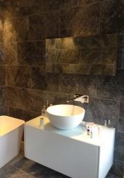 Fully tiled stone bathroom near Tadley