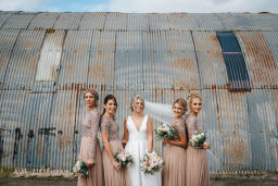 a bride with her bridesmaids at eden barn
