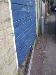 Garage Door Secured after Forced Entry.
