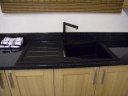 Astral Quarts laminate worktop with a black Granite sink, our showroom