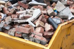 Yellow Skip with brick
