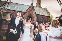 bridal party leaving All Saints Church, Chester