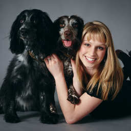 Girl with two dogs in a photography studio