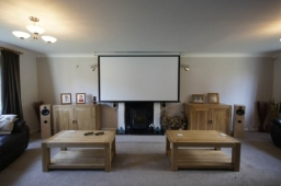 3D Lounge home cinema. The motorised screen hides a wall mounted TV (for casual viewing)