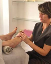 Louise providing a reflexology treatment