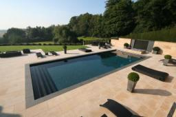 Award winning outdoor pool with automatic safety cover in charcoal mosaic with granite steps