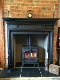cast iron fireplace surround on sale