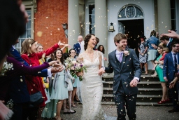 Bride and groom with confetti Gloucestershire