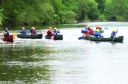 canoeists enjoying the river in summer