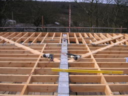 carpenters fitting roof joists in kent