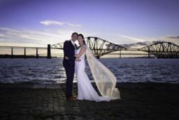Wedding portrait by the Forth bridges.
