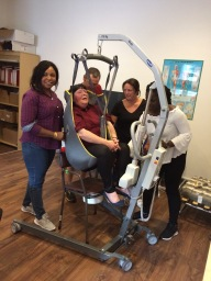 Carers being trained to hoist