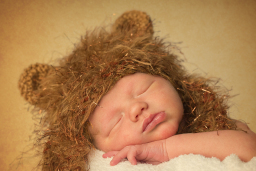 Baby with lions hat on