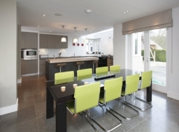 A contemporary kitchen incorporating the client's existing paintings