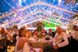 Inside a clear roofed marquee