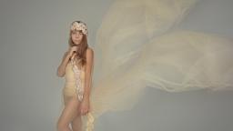 blond girl posing in floating dress
