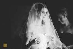 bride  final preparations long veil, black  white