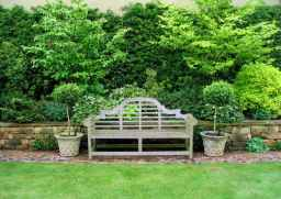 Dry stone wall with teak Lutyens bench