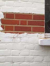 brick paint removal in progress
