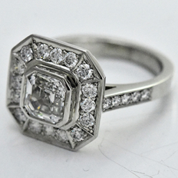 Bespoke asscher cut diamond halo ring in platinum