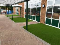 School play area fitted with synthetic grass