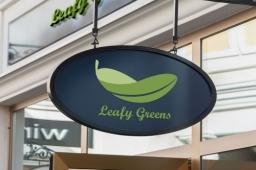 Leafy Greens Logo Design on Shop Sign - Plant-based Cafe