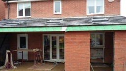 Home extension - New tiled roof with Velux windows