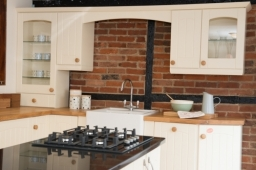 Traditional - Cherwell design in Vanilla with oak and granite worktops, Neff gas hob and Blanco Belfast sink